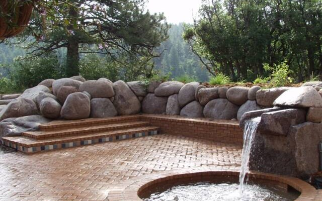 granite boulder retaining wall with quarried granite and brick water feature 2